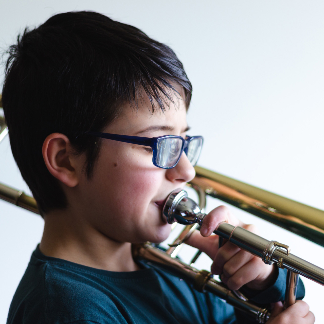 Boy Learning Trombone
